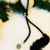 Γούρι μαύρη φούντα με διάφανο μάτι απο plexiglass και επιχρυσωμένο 20